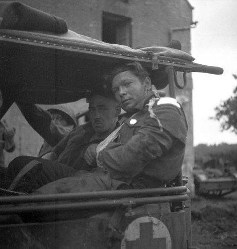 Wounded Le Regiment de la Chaudiere,Carpiquet,France,4 July 1944.jpg