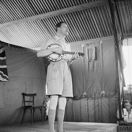 Click image for larger version  Name:GEORGE FORMBY ENTERTAINS NORTH AFRICA TROOPS, 1943.jpg Views:1 Size:95.7 KB ID:115740